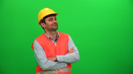 Architect or Construction Worker Looking Up on Green Screen. Left Side.