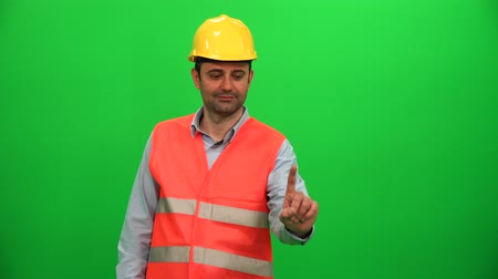 Engineer Man Touching Virtual Monitor on Green Screen Vídeos