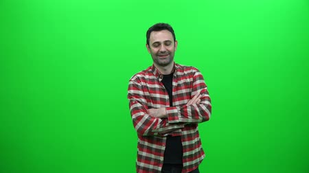 Young Man Crossing Arms on Green Screen Vídeos