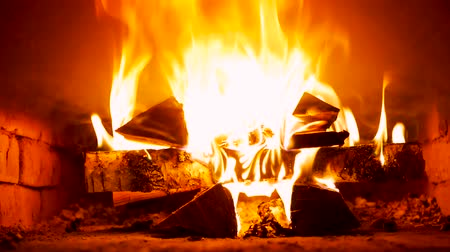 fire arms : Mixing wood-burning in the russian stove Stock Footage