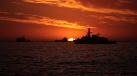 Warship and Cargo Ships at Sunset on the coasts of Valparaiso, Chile