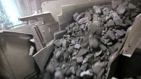 Copper rocks are Transported by a conveyor belt after being crushed in a primary crusher Stock Footage