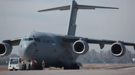 Large military transport plane US Air Force C-17 Globemaster jet getting ready for departure March 25, 2010 in Santiago, Chile Stock Footage