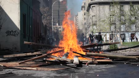 protestor : Street Damage Caused During a student strike on September 22, 2011 in Santiago, Chile. Protesters demand the government to Improve education quality.