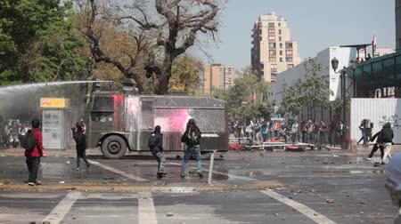 water cannon : Chilean riot Police disperse protesters During a student strike on October 6, 2011 in Santiago, Chile. Protesters demand the government to Improve Education Quality