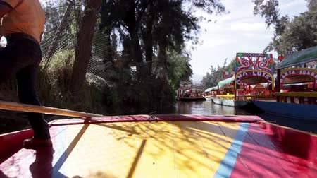 MEXICO CITY, MEXICO - FEBRUARY 04, 2018: Hand painted trajineras chowing the traditional colors of Mexico, a beautiful unique waterline that provides tours to people around the world Stock Footage