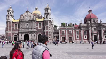 MEXICO CITY, MEXICO - FEBRUARY 11, 2018: The ancient Basilica of Our Lady of Guadalupe (1709). Basilica is one of the most important pilgrimage sites of Catholicism, it is visited by several million people every year. Stock Footage