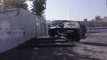 blindado : Santiago, Chile - April 19, 2018: Riot Police armored vehicle blocks entrance of the University of Santiago during a demonstration demanding an end to the Profit in the Education.