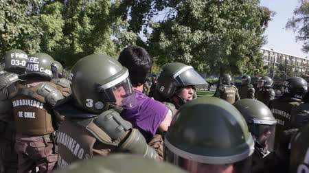 gösterici : Santiago, Chile - April 19, 2018: Protester arrested in the University of Santiago during a demonstration demanding an end to the Profit in the Education. Stok Video