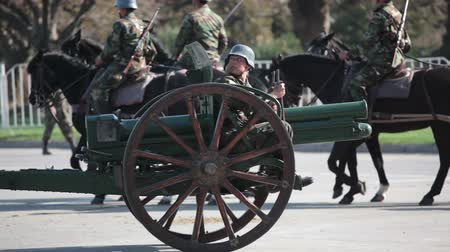 legion : Santiago, Chile - September 15, 2011: Soldiers marching with an ancient piece of artillery Krupp gun in a rehearsal of the Great Military Parade Stock Footage