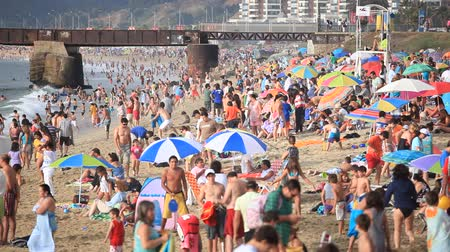 parasol : Vina del Mar, CHILE - February 13, 2012: Bathers on the Beach in Vina del Mar, During the summer season Stock Footage