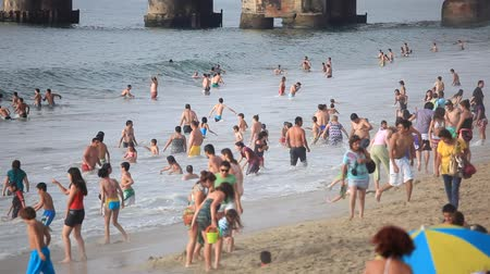 Vina del Mar, CHILE - February 13, 2012: Bathers on the Beach in Vina del Mar, During the summer season Stock Footage