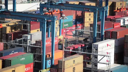 VALPARAISO, CHILE - January 03, 2011: Cargo containers and RTG container cranes cranes in the port of Valparaiso. Chile Stock Footage