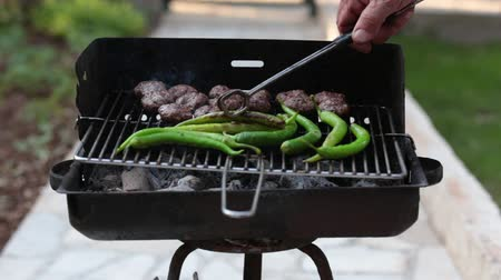 méz : Cooking long green pepper at charcoal barbecue grill