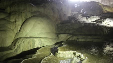 molas : water falling on travertine terraces in the cave