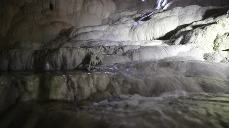 travertino : water falling on travertine terraces in the cave