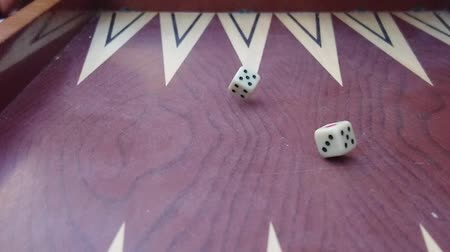 probabilidade : Slow Motion Rolling Dice On A Backgammon Game Stock Footage