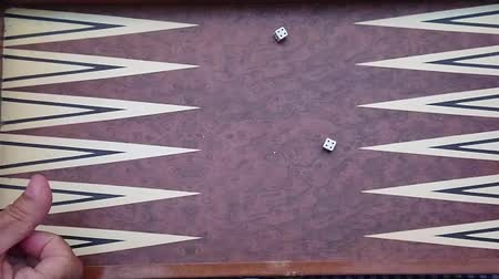 oportunidade : Throwing Dice Slow Motion on Backgammon Board, From Above Stock Footage