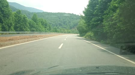 super car : Driving car on a road with trees in the Turkey. Super slow motion. Pov.