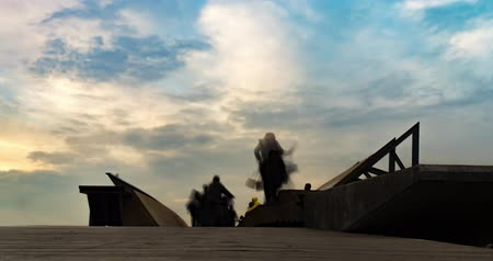 unidentified : Silhouettes of people crossing a bridge fast motion time lapse at Karsiyaka. Stock Footage