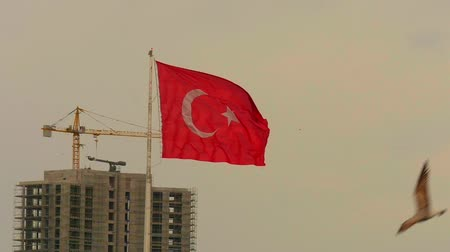 félhold : Turkish flag waving Slow Motion with the construction building background.