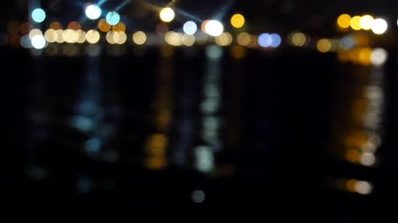blurred lights : Colorful defocused Seaside city night lights flickering and waving reflection.