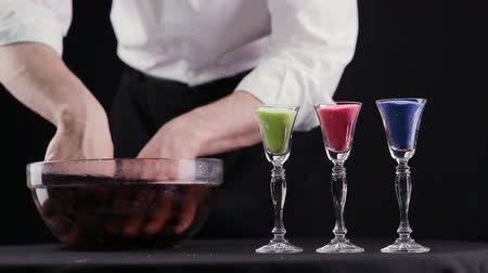inducement : magician shows the trick with water. the water in the bowl darkens Stock Footage