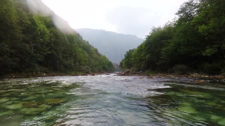 tutaj : rain on the mountain river Tara during rafting