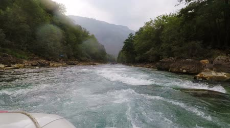 another : rain on the mountain river Tara during rafting