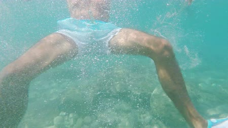 man is swimming in the Adriatic Sea