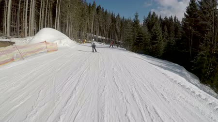 snowboarder : Skiers skiing down on slopes in Bukovel ski resort. Stock Footage
