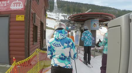 chairlift : Skiers and snowboarders are in line for ski lift Stock Footage