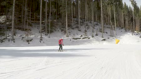Skiers skiing down on slopes Stock Footage
