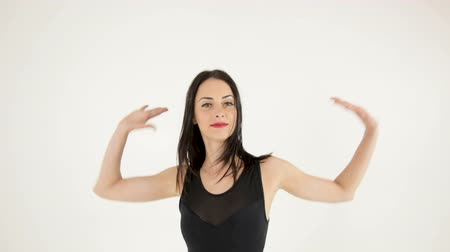 attractive woman dancing and looking at camera Stock Footage