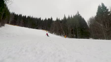 ski boots : skier skiing on ski slope on winter day Stock Footage