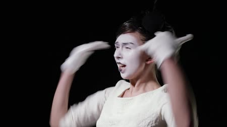 žolík : mime woman in white dress emotionally shouts at someone