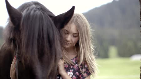 juba : Girl petting horse Stock Footage