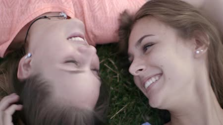 socialising : Female friends lying in grass