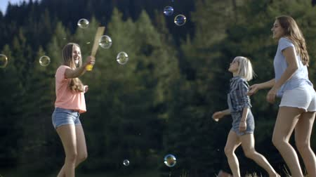 socialising : Friends playing with soap bubbles