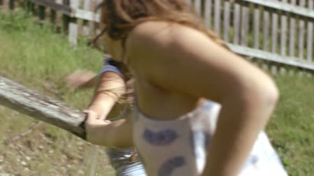 mangueira : Friends playing with water in countryside Stock Footage