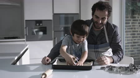 pai : Father and son baking biscuits in Kitchen