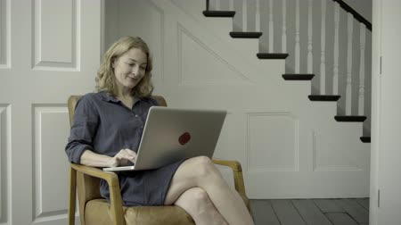 affluent : Mature Adult Female working from home on laptop
