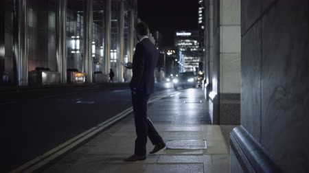 london cab : Business male waiting for Taxi outside office Stock Footage