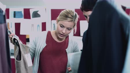 dressmakers model : Fashion designers looking at designs in studio Stock Footage