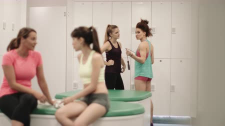 locker : Young women relaxing in changing room after work out
