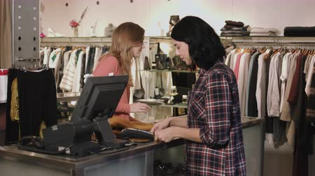 chip and pin : Consumer purchasing at till in clothes shop