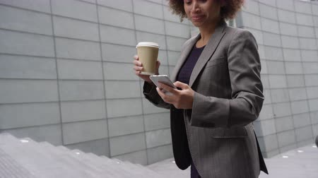 Businesswoman using smart phone and on the move Stok Video