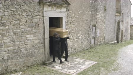 crematorium : Pallbearers leaving with coffin