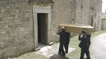 crematorium : Pallbearers walking into church with coffin Stock Footage