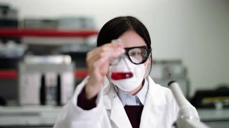 Scientist wearing lab coat working in laboratory Stok Video